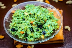 Halwa of Lagenaria siceraria,bottle guard[Dudhi ka halwa] an Indian sweet dessert served before or after lunch with dry fruits li. Popular Indian & Asian dessert Stock Image