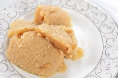 Halwa semolina. Halwa is famouse mome made Turkish sweet made with suji (semolina Stock Photos