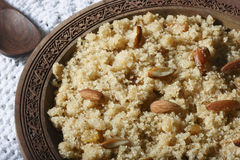 Halwaua e Aurd Sujee - a Semolina Pudding. Close up view of halwa. Halwaua e Aurd Sujee is a sweet dish made from Semolina, popular in North-West India Royalty Free Stock Photography