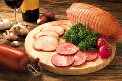 Ham. Different kinds of ham arranged on a chopping board stock photography
