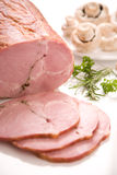 Ham. Slices with herbs and mushrooms Royalty Free Stock Photography