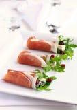Ham with arugula,gorgonzola and cranberry. Prosciutto with arugula,gorgonzola and cranberry stock photo