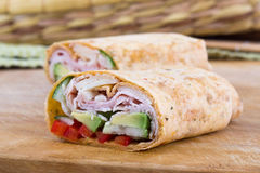 Ham and avocado sandwich wrap roll Royalty Free Stock Images