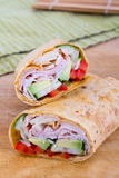 Ham and avocado sandwich wrap roll Stock Photos