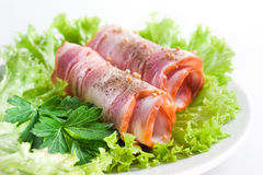 Ham. Bacon roll with spice and herbs Royalty Free Stock Photos