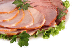 Ham and beef slices. On white plate, close-up, isolated on white background Royalty Free Stock Photos
