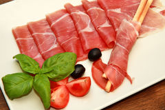Ham and bread-stick stock image