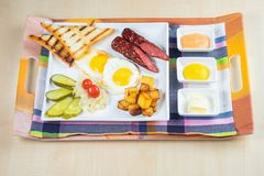 Ham bread with vegetable salad and tomato on a table and paper stock images