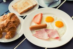 Ham breakfast served with coffee, toast and salads that taste go Royalty Free Stock Photos