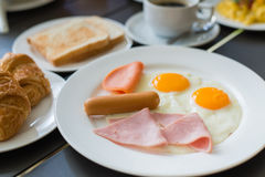 Ham breakfast served with coffee, toast and salads that taste go Stock Photo