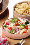 Ham Broccoli Pasta. In Wooden bowl Stock Photo