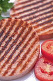Ham Burgers with tomatoes Royalty Free Stock Photos