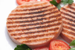 Ham Burgers with tomatoes Royalty Free Stock Image