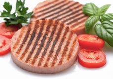 Ham burgers with tomatoes on white background Royalty Free Stock Photography