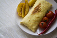 Ham burrito with hot spicy vegetables Royalty Free Stock Images