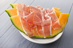 Ham and cantaloupe melon Stock Image