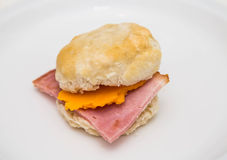 Ham and Cheese Biscuit. A fresh, hot ham and cheese biscuit on a white plate Stock Images