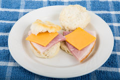 Ham and Cheese Biscuits on White Plate Stock Photography