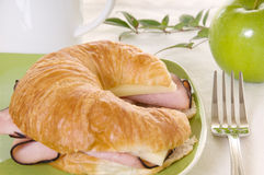 Ham and Cheese on Croissant with Green Accents Royalty Free Stock Photos