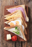 Ham, cheese and egg sandwiches Royalty Free Stock Images
