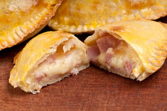 Ham and Cheese Empanada Close Up. Ham and Cheese Empanada fill close up.  The Empanada is a pastry turnover filled with a variety of savory ingredients and baked Stock Image