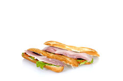 Ham and cheese French bread. White and brown French bread with ham and cheese, reflective surface, copy-space Stock Image