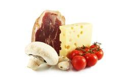 Ham, cheese, mushroom and tomatoes. Still Life with ham, cheese, mushrooms, tomatoes and garlic Royalty Free Stock Image