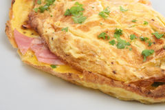 Ham & Cheese Omelet. Freshly made omelet filled with ham and cheese stock image