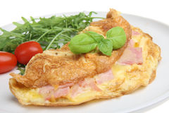 Ham & Cheese Omelet. With rocket salad royalty free stock images