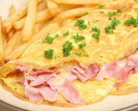 Ham & Cheese Omelet with Fries Royalty Free Stock Photos