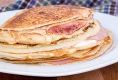 Ham and cheese pancake breakfast. Closeup Stock Photos