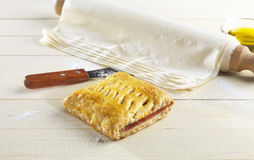 Ham and cheese pie on a kitchen table Stock Photo