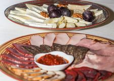 Ham and cheese platters large plates Stock Photography
