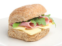 Ham & Cheese Roll. Ham and Cheddar cheese in a wholemeal bread roll with rocket Stock Image