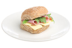Ham and Cheese Roll. Ham and Cheddar cheese in a wholemeal bun with rocket Royalty Free Stock Image