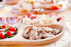 Ham, cheese, salami, prosciutto and cherry tomatoes Royalty Free Stock Photos