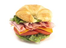 Ham and Cheese Sandwhich with Lettuce Cheese and Tomatoes. On a Fresh Croissant royalty free stock photography