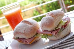 Ham and cheese sandwich. On portuguese rolls served with juice Royalty Free Stock Image