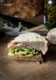 Ham and cheese sandwich. Closeup of half a ham and cheese sandwich with lettuce on sourdough bread Royalty Free Stock Photo