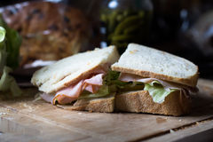 Ham and cheese sandwich. Closeup of half a ham and cheese sandwich with lettuce on sourdough bread Stock Photography