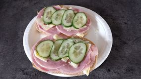 Ham and cheese sandwich on kitchen countertop. With cucumber slices on top close up full frame photo stock photo