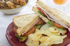 Ham and cheese sandwich. Served with chips and soup with drink stock photo
