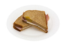 Ham and cheese sandwich on a white paper plate Stock Photo