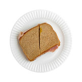 Ham and cheese sandwich on a white paper plate Royalty Free Stock Images