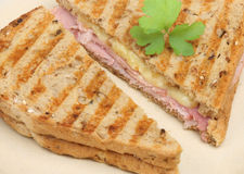 Ham & Cheese Toastie. Pressed toasted sandwich or panini with ham and cheese Stock Photography