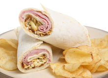Ham & Cheese Wrap with Crisps. Tortilla wrap with ham, cheese & pickle and potato crisps Royalty Free Stock Photography