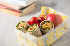 Ham and cheese wraps in lunch box Royalty Free Stock Images