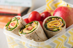 Ham and cheese wraps in lunch box Royalty Free Stock Photo