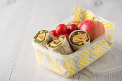 Ham and cheese wraps in lunch box Stock Photos