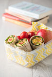 Ham and cheese wraps in lunch box Stock Photo